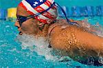 Woman swimming butterfly stroke, (close-up) Stock Photo - Premium Royalty-Free, Artist: Aflo Sport, Code: 693-06014639
