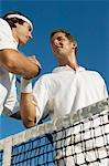 Tennis Players Shaking Hands at Net, low angle view Stock Photo - Premium Royalty-Free, Artist: Raymond Forbes, Code: 693-06014681
