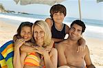 Family in swimwear sitting together on beach, portrait Stock Photo - Premium Royalty-Free, Artist: Siephoto, Code: 693-06014709