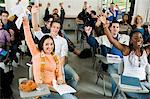 Students raising hands in classroom Stock Photo - Premium Royalty-Free, Artist: CulturaRM, Code: 693-06014808