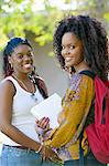 Two female students smiling, outdoors, (portrait) Stock Photo - Premium Royalty-Freenull, Code: 693-06014817