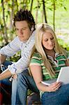 Young couple relaxing outdoors Stock Photo - Premium Royalty-Freenull, Code: 693-06014819