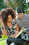 Student couple studying outdoors Stock Photo - Premium Royalty-Freenull, Code: 693-06014823