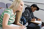 University students working in lecture hall Stock Photo - Premium Royalty-Freenull, Code: 693-06014829
