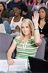 Female University student raising hand in class Stock Photo - Premium Royalty-Freenull, Code: 693-06014834