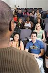 Lecturer teaching University students in lecture hall Stock Photo - Premium Royalty-Freenull, Code: 693-06014835