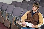 Male University student sitting in lecture hall Stock Photo - Premium Royalty-Freenull, Code: 693-06014840