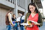 Female university student holding book, outdoors Stock Photo - Premium Royalty-Freenull, Code: 693-06014846
