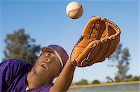 Baseball outfielder catching ball, (close-up) Stock Photo - Premium Royalty-Freenull, Code: 693-06014901