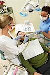 Dentists examining male patient in surgery Stock Photo - Premium Royalty-Free, Artist: Robert Harding Images, Code: 693-06014957