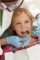 preteen open mouth - Girl (7-10) having teeth examined at dentists Stock Photo - Premium Royalty-Freenull, Code: 693-06014963