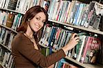 Young woman in Library, selecting book from shelf Stock Photo - Premium Royalty-Free, Artist: AWL Images, Code: 693-06014973