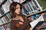 Female University student studying in library Stock Photo - Premium Royalty-Freenull, Code: 693-06015011