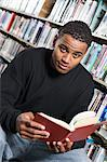 Male University student reading in library, portrait Stock Photo - Premium Royalty-Freenull, Code: 693-06015017
