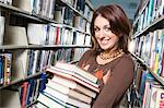 Female University student holding books in library, portrait Stock Photo - Premium Royalty-Freenull, Code: 693-06015027