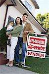 Family standing in front of house with For Sale sign, portrait Stock Photo - Premium Royalty-Free, Artist: Blend Images, Code: 693-06015047