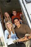 Family sitting in doorway of RV, group portrait Stock Photo - Premium Royalty-Free, Artist: Damir Frkovic, Code: 693-06015059