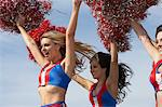 Cheerleaders running holding pom poms in air Stock Photo - Premium Royalty-Free, Artist: Aflo Relax, Code: 693-06015065