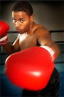 shirtless men - Boxer with red boxing gloves Stock Photo - Premium Royalty-Freenull, Code: 693-06015144