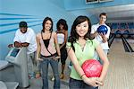 Group of friends at bowling alley, some holding balls, portrait Stock Photo - Premium Royalty-Free, Artist: Aflo Relax, Code: 693-06015209