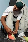 Young man tying bowling shoes, portrait Stock Photo - Premium Royalty-Free, Artist: R. Ian Lloyd, Code: 693-06015227