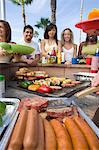 Friends at Barbecue Stock Photo - Premium Royalty-Free, Artist: Blend Images, Code: 693-06015278