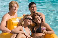 Young Friends at Swimming Pool Stock Photo - Premium Royalty-Freenull, Code: 693-06015291