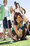 Young Woman Playing Mini Golf with Friends Stock Photo - Premium Royalty-Free, Artist: Aflo Sport, Code: 693-06015320