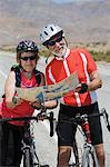 Senior couple with bikes reading map Stock Photo - Premium Royalty-Free, Artist: Cultura RM, Code: 693-06015393