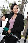 Businesswoman filling car at gas station Stock Photo - Premium Royalty-Free, Artist: Ascent Xmedia, Code: 693-06015522