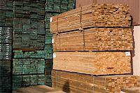 Stacks of wood in warehouse Stock Photo - Premium Royalty-Freenull, Code: 693-06015577