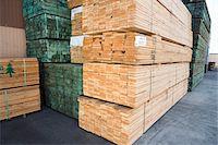 Stacks of wood outside warehouse Stock Photo - Premium Royalty-Freenull, Code: 693-06015584