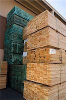 Stacks of wood outside warehouse Stock Photo - Premium Royalty-Freenull, Code: 693-06015585