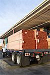 Truck loaded with wood outside warehouse Stock Photo - Premium Royalty-Free, Artist: Ron Fehling, Code: 693-06015623