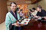 Waitress serving sushi to restaurant Stock Photo - Premium Royalty-Free, Artist: Aflo Relax, Code: 693-06015654