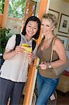 Two women with tickets on vacation, portrait Stock Photo - Premium Royalty-Free, Artist: Michael Mahovlich, Code: 693-06016005