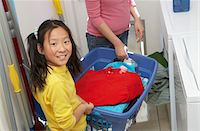 Mother and daughter (7-9) doing laundry Stock Photo - Premium Royalty-Freenull, Code: 693-06016151