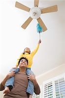 Family including girl (10-12) cleaning house Stock Photo - Premium Royalty-Freenull, Code: 693-06016238