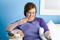fat lady sitting - Overweight woman watching television, eating Stock Photo - Premium Royalty-Freenull, Code: 693-06016365