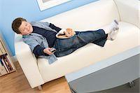 Boy Eating Donuts Stock Photo - Premium Royalty-Freenull, Code: 693-06016377