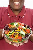 Man Holding Salad Stock Photo - Premium Royalty-Freenull, Code: 693-06016394