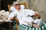 Senior woman wearing bathrobe, relaxing outdoors Stock Photo - Premium Royalty-Free, Artist: Aflo Relax, Code: 693-06016499