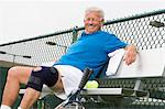 Man wearing knee band on tennis court Stock Photo - Premium Royalty-Free, Artist: Blend Images, Code: 693-06016673