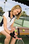 Tennis player putting on wristband Stock Photo - Premium Royalty-Free, Artist: Yvonne Duivenvoorden, Code: 693-06016679