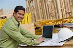 Construction worker using laptop, portrait Stock Photo - Premium Royalty-Free, Artist: ableimages, Code: 693-06016715