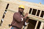 Construction worker carrying wooden plank Stock Photo - Premium Royalty-Free, Artist: ableimages, Code: 693-06016721