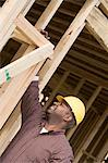 Construction worker measuring building Stock Photo - Premium Royalty-Free, Artist: Cultura RM, Code: 693-06016724