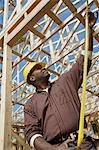 Construction worker measuring building Stock Photo - Premium Royalty-Free, Artist: ableimages, Code: 693-06016727