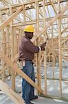 Construction worker hammering framework Stock Photo - Premium Royalty-Free, Artist: Aflo Relax, Code: 693-06016733