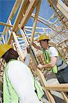 Two construction workers measuring building framework Stock Photo - Premium Royalty-Free, Artist: AWL Images, Code: 693-06016739